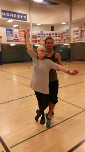 Janis dancing with her zumba instructor, Angel