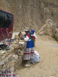 Quechua woman with a baby on her back