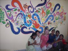 Janis Lindley at Diversion House in India, a safe place for girls previously abused by sex trafficking. Janis and the girls created the mural together.