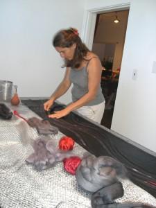 Felting: Flora massages wool into a silk scarf