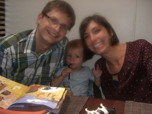 Brendan, Erin and Oliver sharing a Spanish-language book